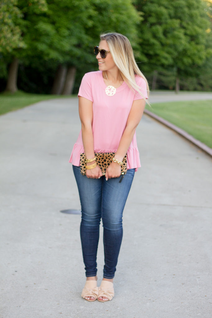 Pink ruffle hem tee with skinny jeans
